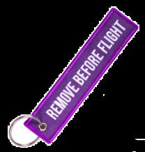 Llavero Remove Before Flight Purpura y Blanco